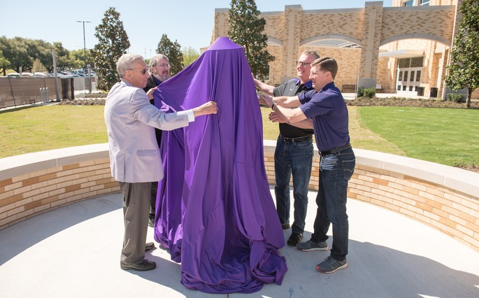Unveiling the sculpture of coach Dutch Meyer are Bill Parrish and Meyer's two great-nephews.